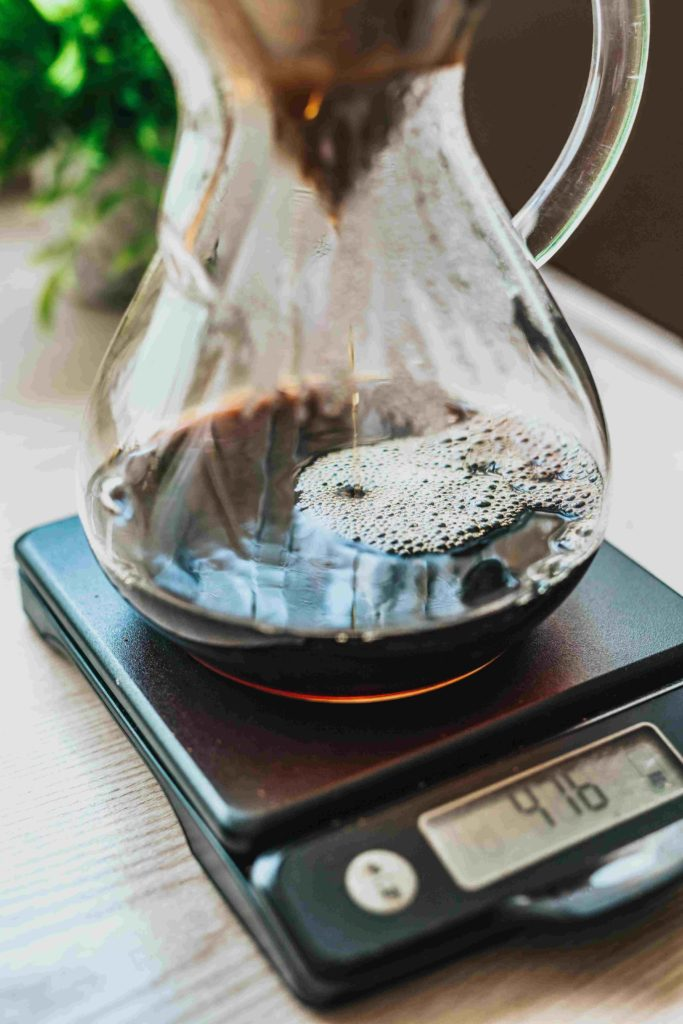 Coffee dripping into a coffee jug v60. Sitting on a measuring scale