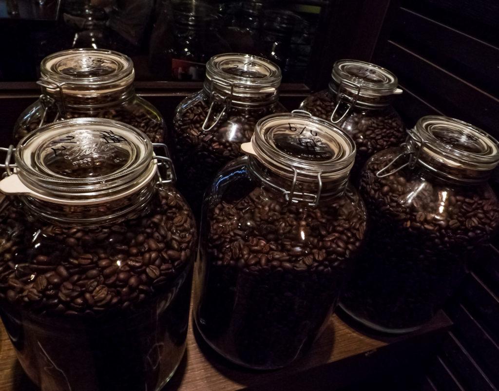 storage jars brimming with coffee beans freshly roasted